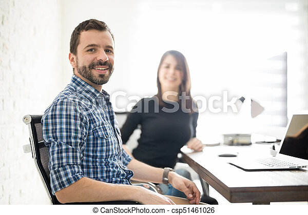 Attractive Hispanic man at his workplace - csp51461026