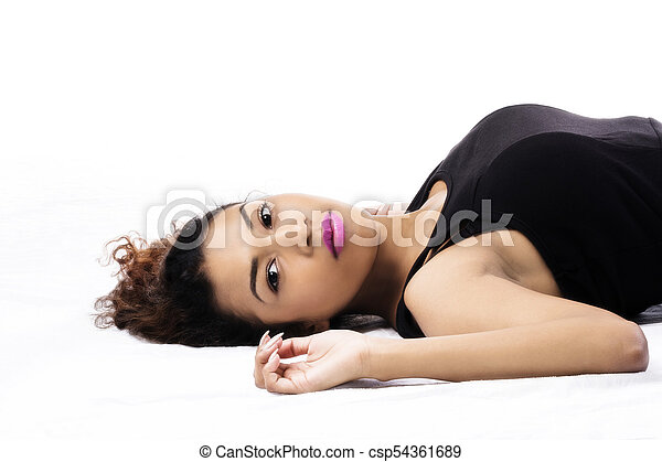 Attractive Hispanic Woman Reclining On Back Black Top - csp54361689