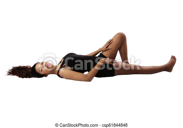 Attractive Hispanic Woman Reclining On White Background - csp61844848