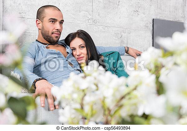 https://cdn.w600.comps.canstockphoto.com/attractive-international-couple-of-man-stock-photograph_csp56493894.jpg
