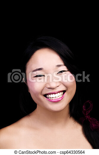 Attractive Japanese American Woman Smiling Portrait Dark Background - csp64330564
