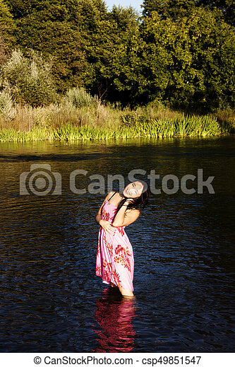 Attractive Japanese American Woman Standing In River - csp49851547