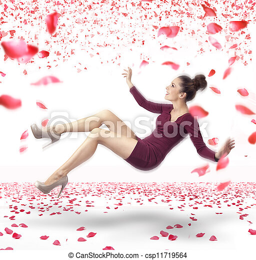 Attractive lady falling down over rose petals background - csp11719564