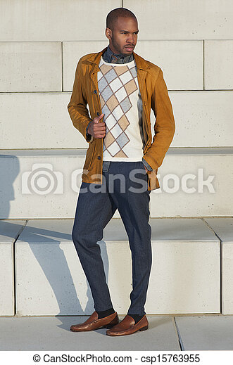 Attractive male fashion model standing outdoors - csp15763955