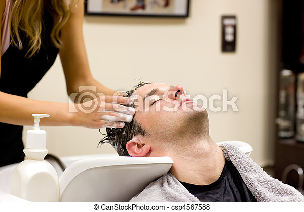 Attractive man having a shampoo - csp4567588
