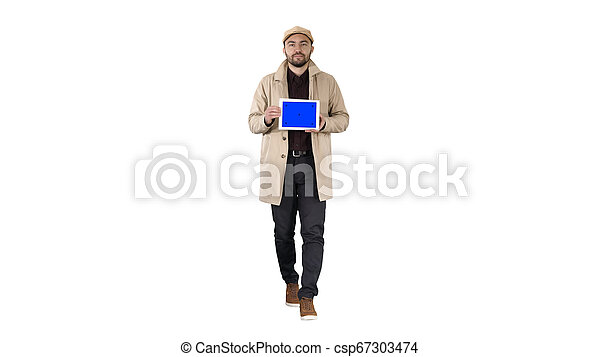 Attractive man holding tablet with blue key screen mockup on white background. - csp67303474