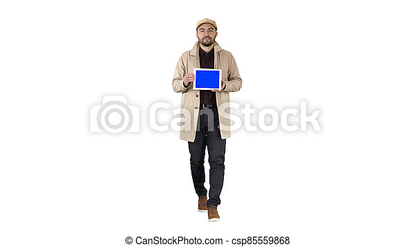 Attractive man holding tablet with blue key screen mockup on whi - csp85559868