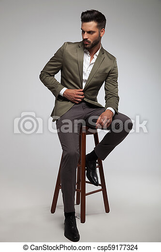 Awe Inspiring Attractive Man In Green Suit Sits On Wood Stool Ocoug Best Dining Table And Chair Ideas Images Ocougorg