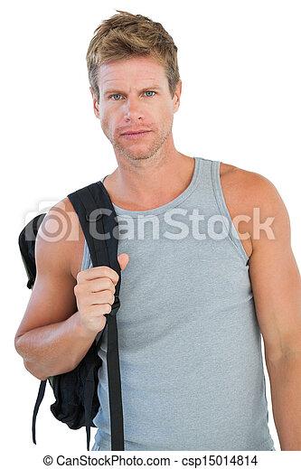 Attractive man in sportswear gesturing - csp15014814