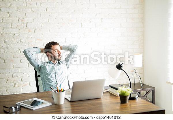 Attractive man taking a break from work - csp51461012