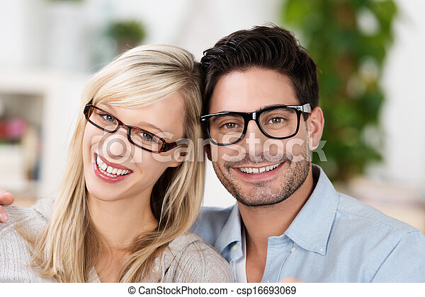 Attractive married couple wearing glasses - csp16693069