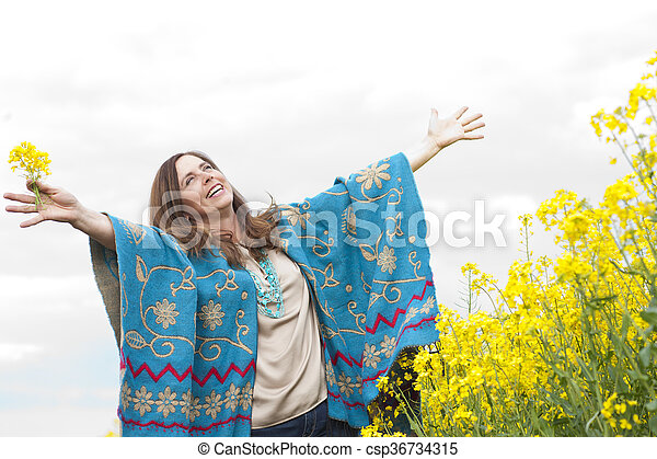 Attractive middle age woman with arms outstretched - csp36734315