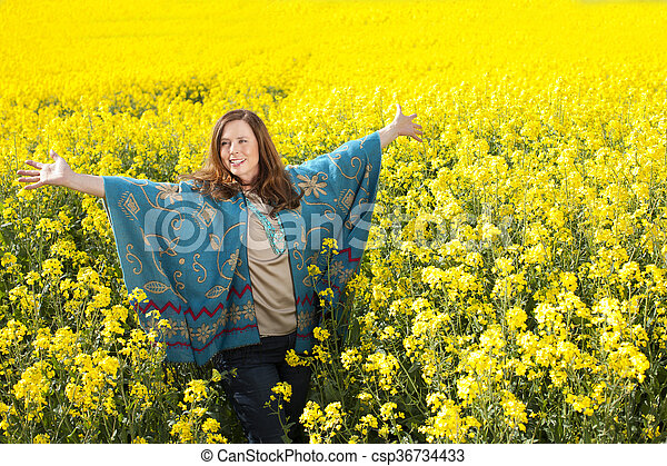 Attractive middle age woman with arms outstretched - csp36734433