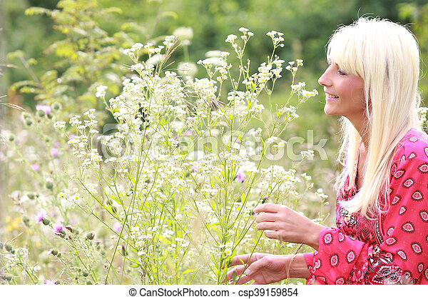 attractive middle age woman with natural flowers - csp39159854