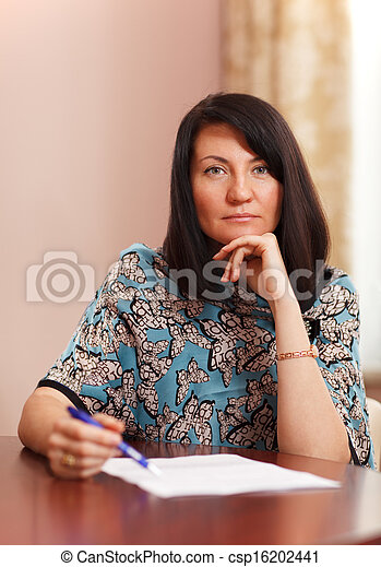 Attractive middle-aged woman working at home - csp16202441