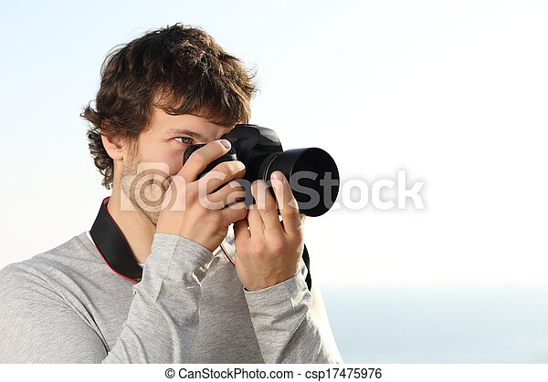 Attractive photograph photographing with a slr camera - csp17475976