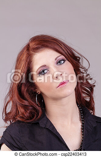 Attractive Red Headed Caucasian Woman Portrait Concerned - csp22403413
