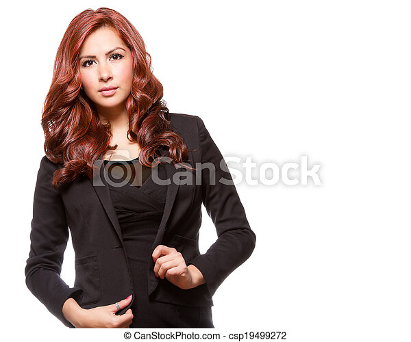 Attractive redheaded business woman in black outfit - csp19499272