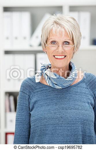 Attractive senior woman wearing glasses - csp19695782
