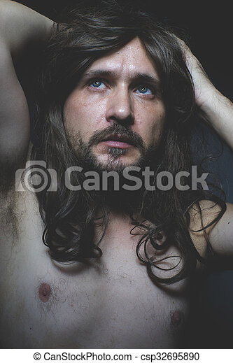 Attractive Sexy Naked Man With Long Dark Hair Intense Eyes And Blue