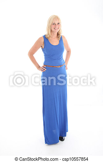 Attractive smiling woman in blue dress - csp10557854