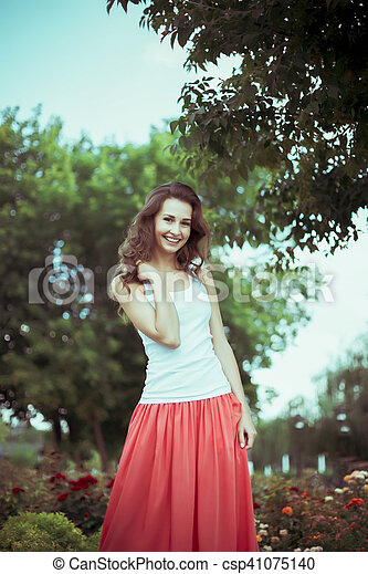 Attractive smiling woman in nature - csp41075140