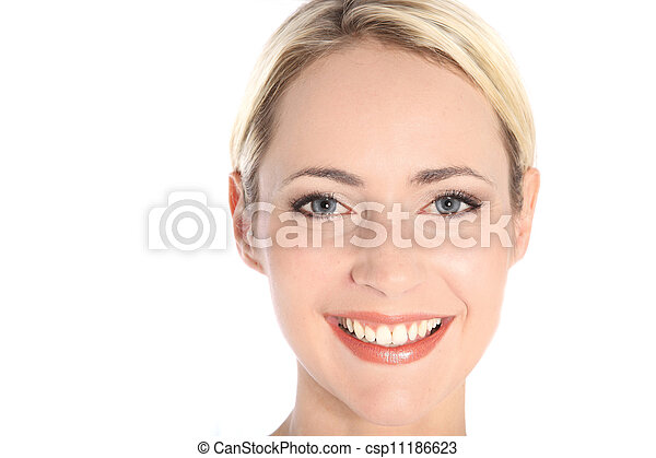 Attractive smiling woman with blue eyes - csp11186623