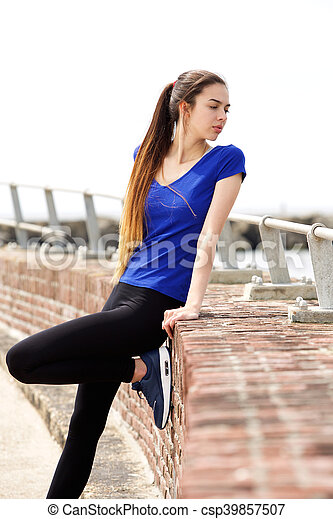 Attractive sporty woman looking over shoulder - csp39857507