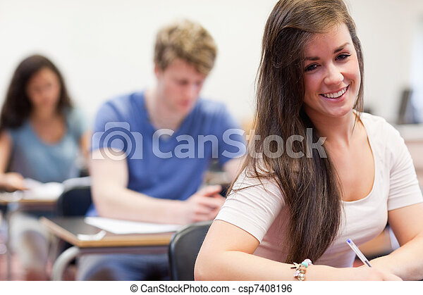 Attractive students having a test - csp7408196