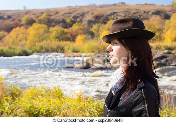 Attractive stylish woman posing in countryside - csp23040940