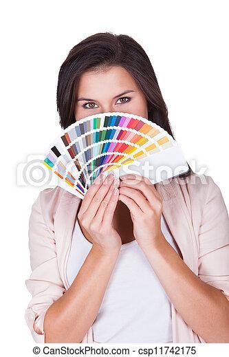 Attractive woman chooses a color scheme - csp11742175
