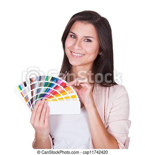 Attractive woman chooses a color scheme - csp11742420