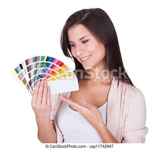Attractive woman chooses a color scheme - csp11742947