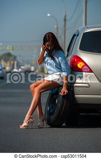 Attractive woman having problem with her car - csp53011504