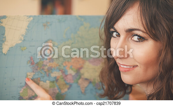 Attractive woman holding a world map - csp21707839