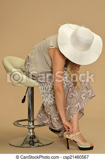 Attractive woman in a dress - csp21460567