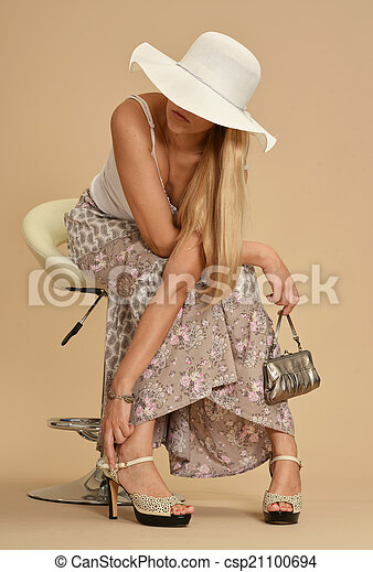 Attractive woman in a dress - csp21100694