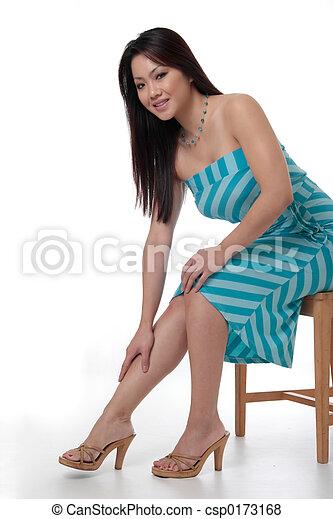 Attractive woman in black dress - csp0173168