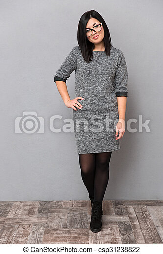 Attractive woman in dress and glasses - csp31238822