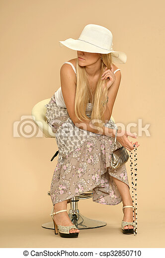 Attractive woman in dress - csp32850710