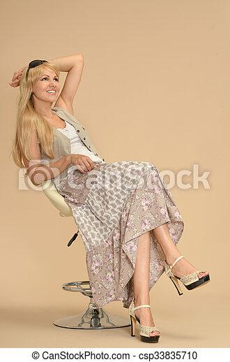 Attractive woman in dress - csp33835710