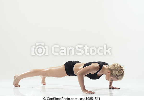 attractive woman in push up exercise pose - csp19851541