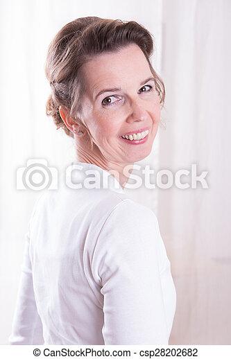 attractive woman looking over shoulder - csp28202682