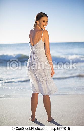 Attractive woman looking over shoulder at camera - csp15770151