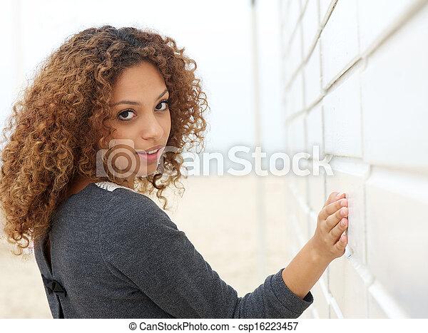 Attractive woman looking over shoulder - csp16223457