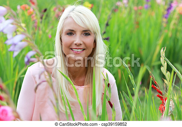Attractive woman middle age in nature - csp39159852