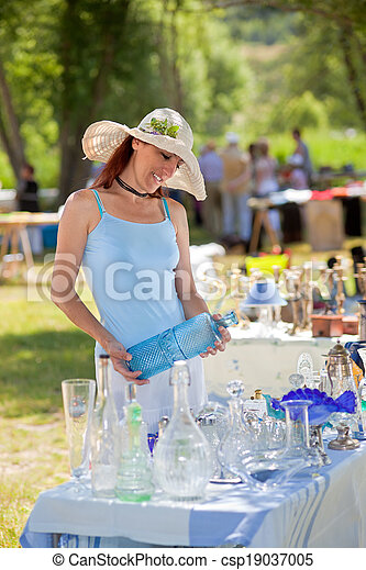 Attractive woman shopping for antiques, Provence, France. - csp19037005