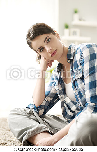 Attractive woman sitting on the floor - csp23755085