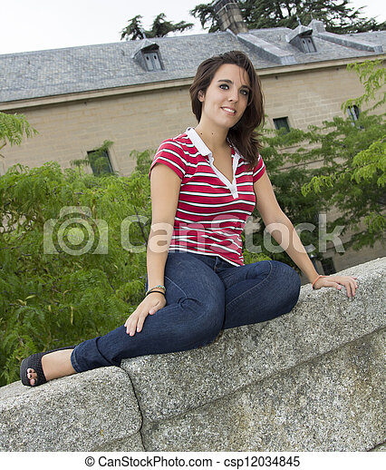 attractive woman sitting on the floor - csp12034845