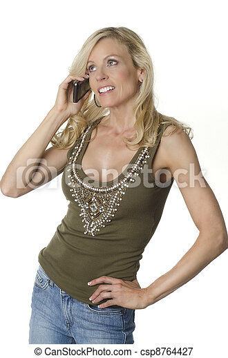 Attractive woman talking on cell ph - csp8764427